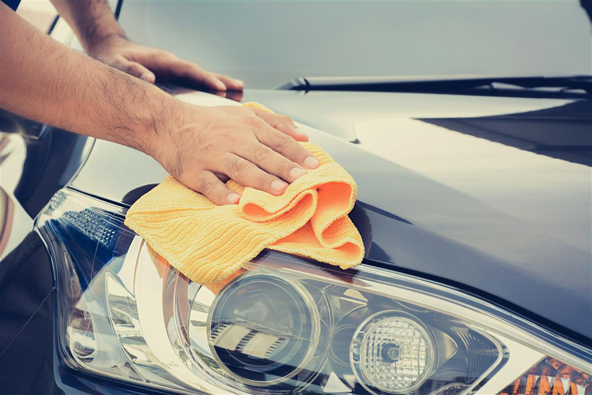 Car Exterior Detailing - Man Cleaning Headlights